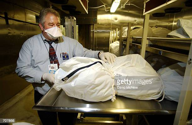 Craig Harvey, Chief Coroner Investigator and Chief of Operations at the Los Angeles County Coroners office, looks at a body in the long-term 600...