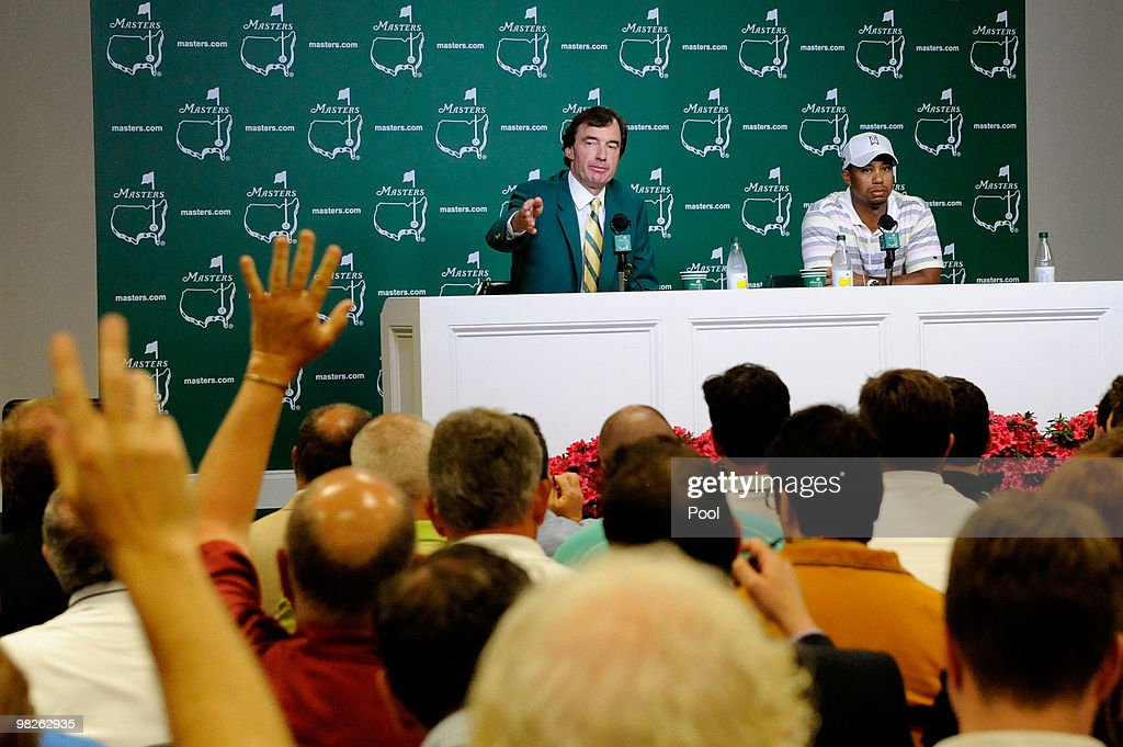 Craig Heatley, Chairman of The Masters Media Committee, sits alongside Tiger Woods as he addresses members of the media during a press conference prior to the 2010 Masters Tournament at Augusta National Golf Club on April 5, 2010 in Augusta, Georgia.