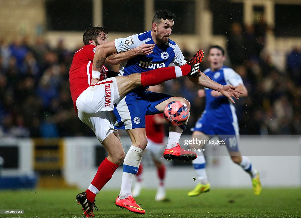 Craig Hobson of Chester and Martin Cranie of Barnsley battles for the ball during the FA Cup Second Round Replay match between Chester City and Barnsley at Deva Stadium on December 16, 2014 in Chester, England.