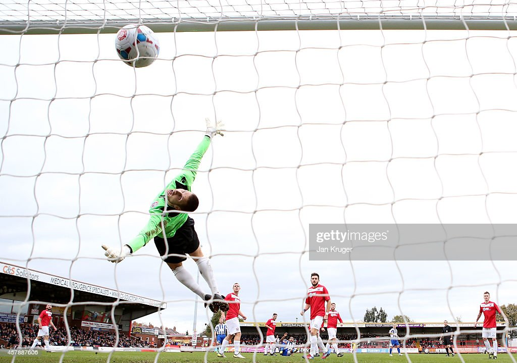 Craig Hollaway, Goalkeeper of Greenwich Borough FC is beaten by Ellis Deeney of Worcester City during the FA Cup Qualifying Fourth Round match between Worcester City and Greenwich Borough at Aggborough Stadium on October 26, 2014 in Kidderminster, England.