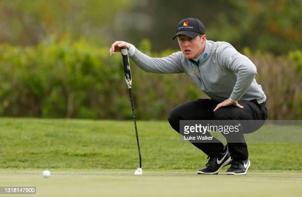 Craig Howie of Scotland lines up a putt on the 18th hole during Day Three of the Range Servant Challenge by Hinton Golf at Hinton Golf Club on May...