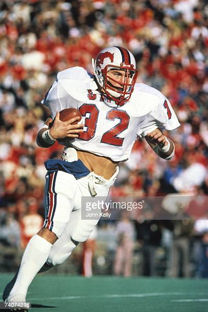 Craig James of Southern Methodist University runs with the ball against BYU during the 1980 Holiday Bowl