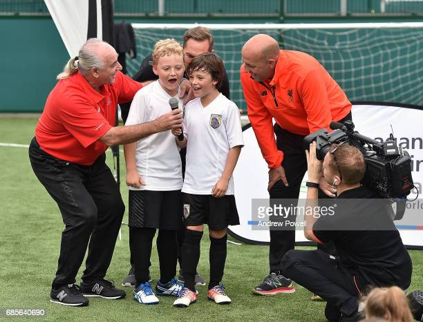Craig Johnston Gary Mcallister and Jason Mcateer legends of Liverpool sing Liverpool anthem You'll Never Walk Alone with some children during a...