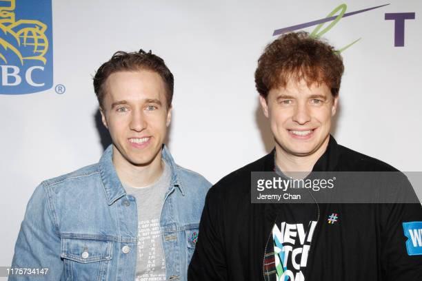 Craig Kielburger and Marc Kielburger attends WE Day Toronto 2019 held at Scotiabank Arena on September 19 2019 in Toronto Canada