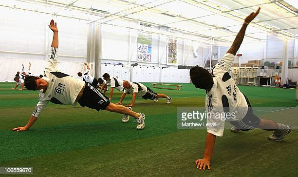 Craig Kieswetter and Jade Dernbach of England warm up during an ECB England Performance Programme Training Session at the National Cricket...