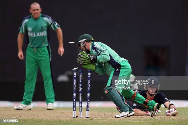Craig Kieswetter of England is run out by Niall O'Brien of Ireland during the ICC T20 World Cup Group D match between England and Ireland at the...