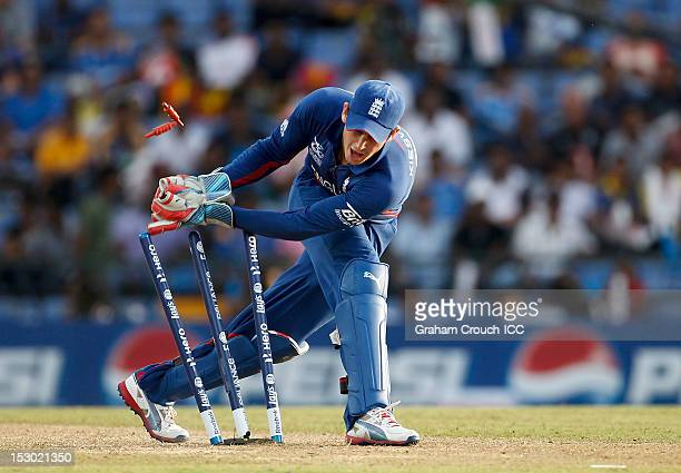 Craig Kieswetter of England runs out James Franklin of New Zealand during the A1 versus B2 ICC World T20 Super Eight match between England and New...