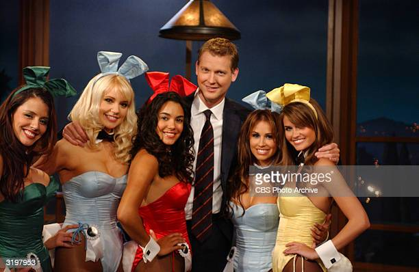 Craig Kilborn host of 'The Late Late Show' poses with Playboy Playmates Penelope Jimenez Stacy Fuson Christina Santiago Jennifer Walcott and Lauren...