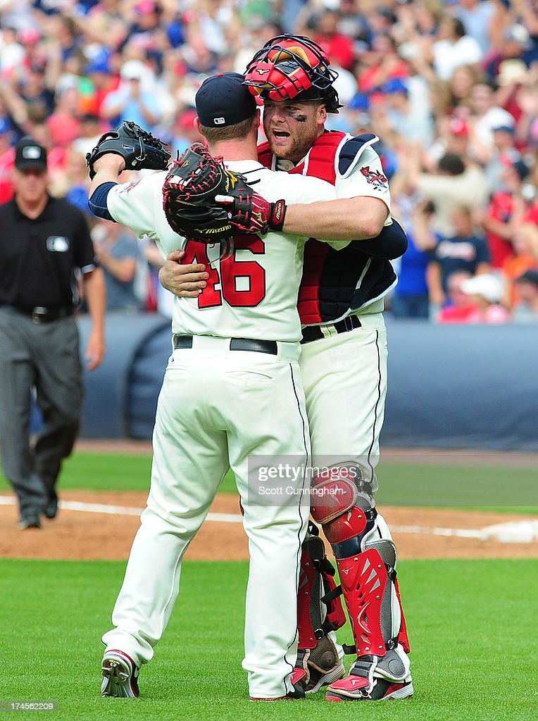 Craig Kimbrel #46 and Brian McCann #16 of the Atlanta Braves celebrate after the game against the St. Louis Cardinals at Turner Field on July 27, 2013 in Atlanta, Georgia.