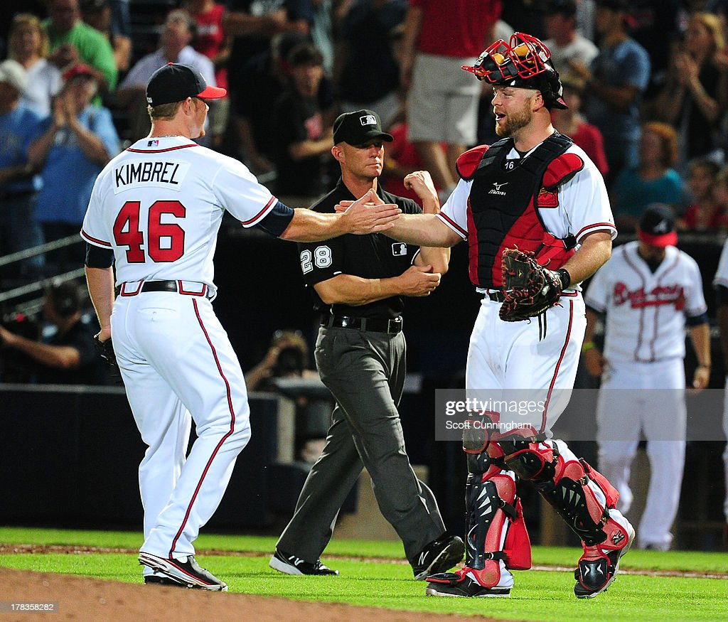 Craig Kimbrel #46 and Brian McCann #16 of the Atlanta Braves celebrate after the game against the Cleveland Indians at Turner Field on August 29, 2013 in Atlanta, Georgia.