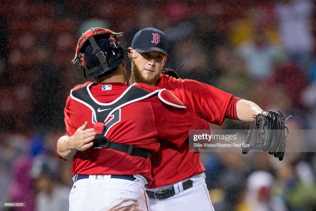 Craig Kimbrel #47 and Christian Vazquez #7 of the Boston Red Sox celebrate a victory against the Seattle Mariners on May 26, 2017 at Fenway Park in Boston, Massachusetts.