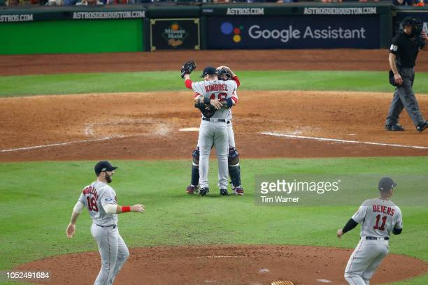 Craig Kimbrel and Christian Vazquez of the Boston Red Sox celebrate and hug after defeating the Houston Astros in Game Five of the American League...