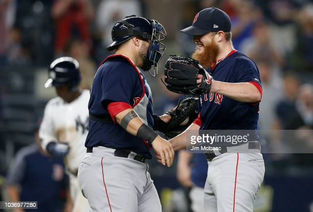 Craig Kimbrel and Sandy Leon of the Boston Red Sox celebrate after defeating the New York Yankees at Yankee Stadium on September 20 2018 in the Bronx...