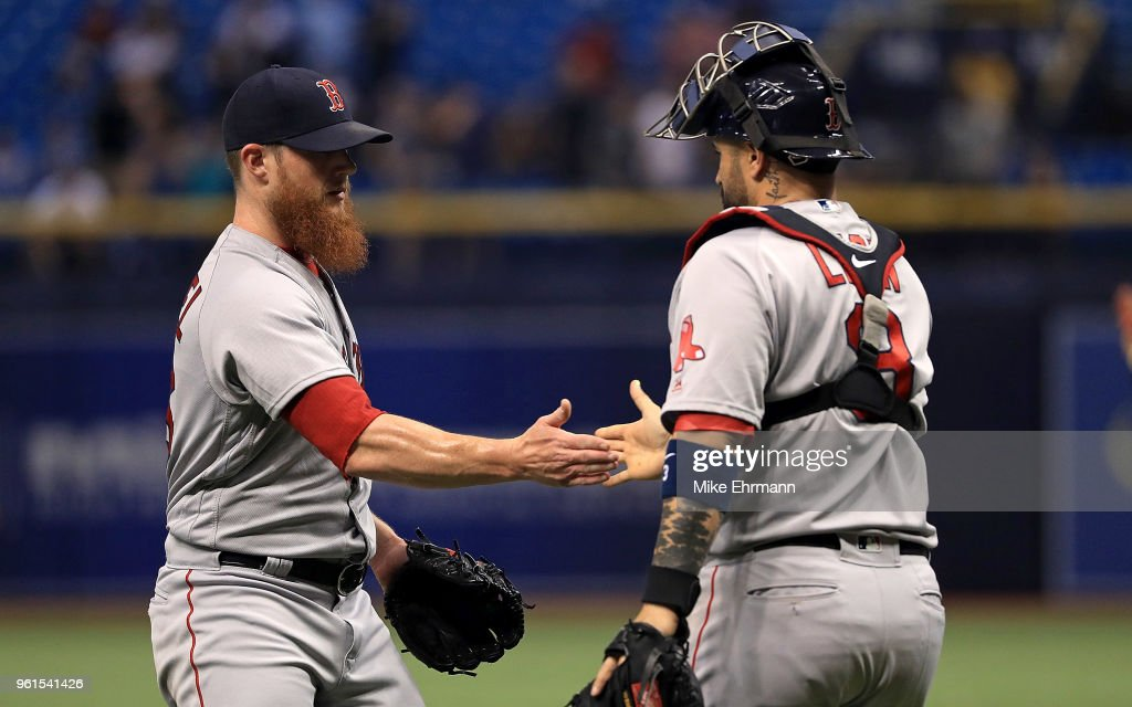 Craig Kimbrel #46 and Sandy Leon #3 of the Boston Red Sox celebrate winning a game against the Tampa Bay Rays at Tropicana Field on May 22, 2018 in St Petersburg, Florida.