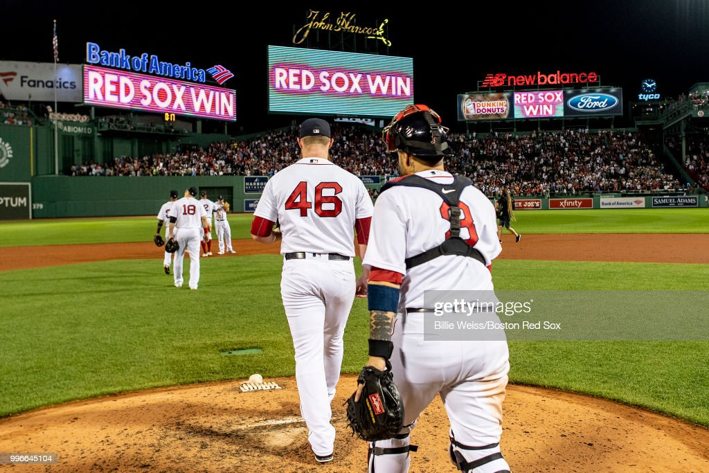 Craig Kimbrel #46 and Sandy Leon #3 of the Boston Red Sox looks on after a game against the Texas Rangers on July 11, 2018 at Fenway Park in Boston, Massachusetts.
