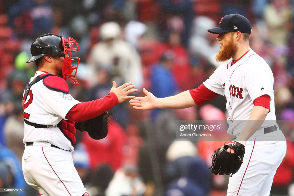 Craig Kimbrel #46 celebrates with Christian Vazquez #7 of the Boston Red Sox after a victory over the Baltimore Orioles at Fenway Park on April 15, 2018 in Boston, Massachusetts. All players are wearing #42 in honor of Jackie Robinson Day.