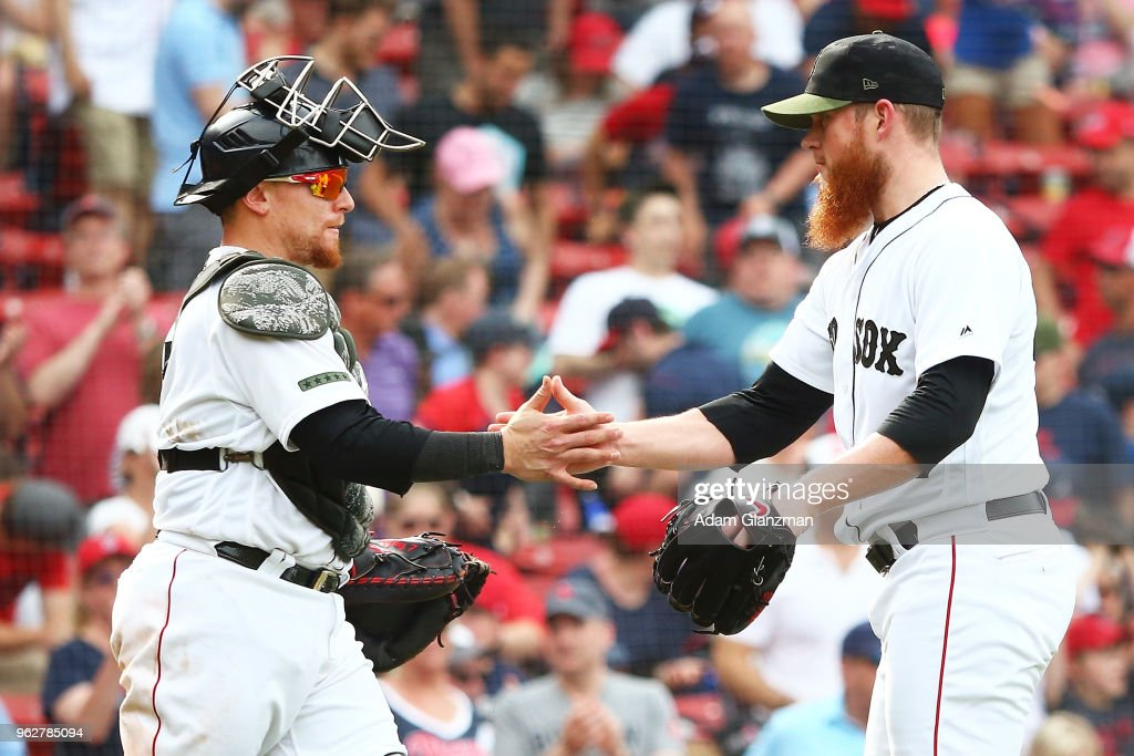 Craig Kimbrel #46 embraces Christian Vazquez #7 of the Boston Red Sox after a victory over the Atlanta Braves at Fenway Park on May 26, 2018 in Boston, Massachusetts.