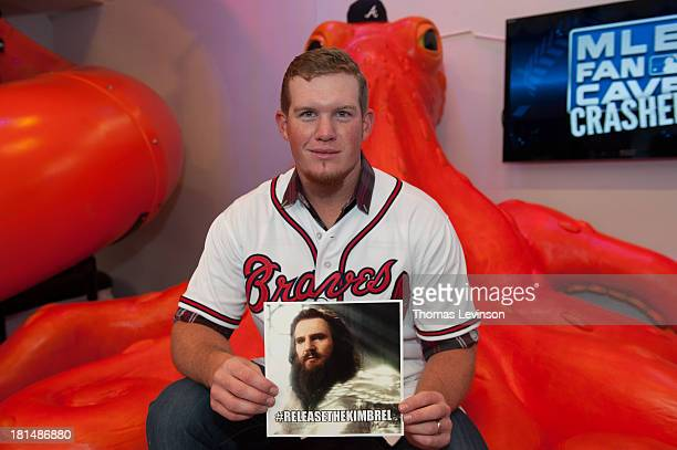 Craig Kimbrel of the Atlanta Braves poses with a internet meme during a visit to the MLB Fan Cave on August 20 2013 at Broadway and 4th Street in New...