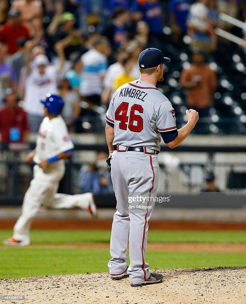Craig Kimbrel #46 of the Atlanta Braves reacts after the final out of the game as Ruben Tejada #11 of the New York Mets rounds third base at Citi Field on August 27, 2014 in the Flushing neighborhood of the Queens borough of New York City.