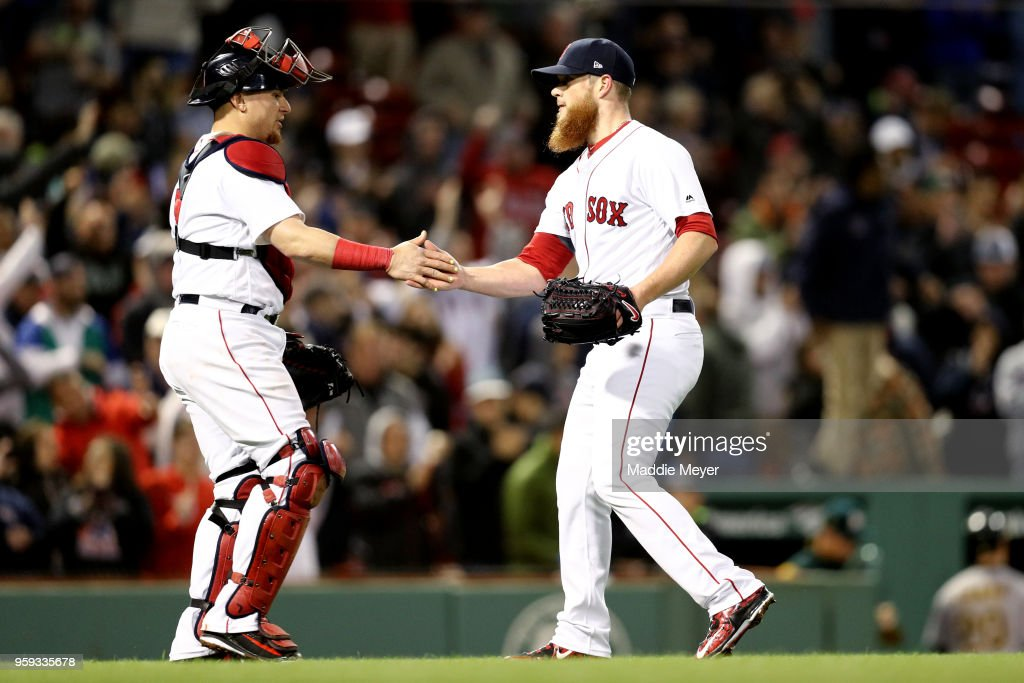 Craig Kimbrel #46 of the Boston Red Sox and Christian Vazquez #7 celebrate after defeating the Oakland Athletics 6-4 at Fenway Park on May 16, 2018 in Boston, Massachusetts.