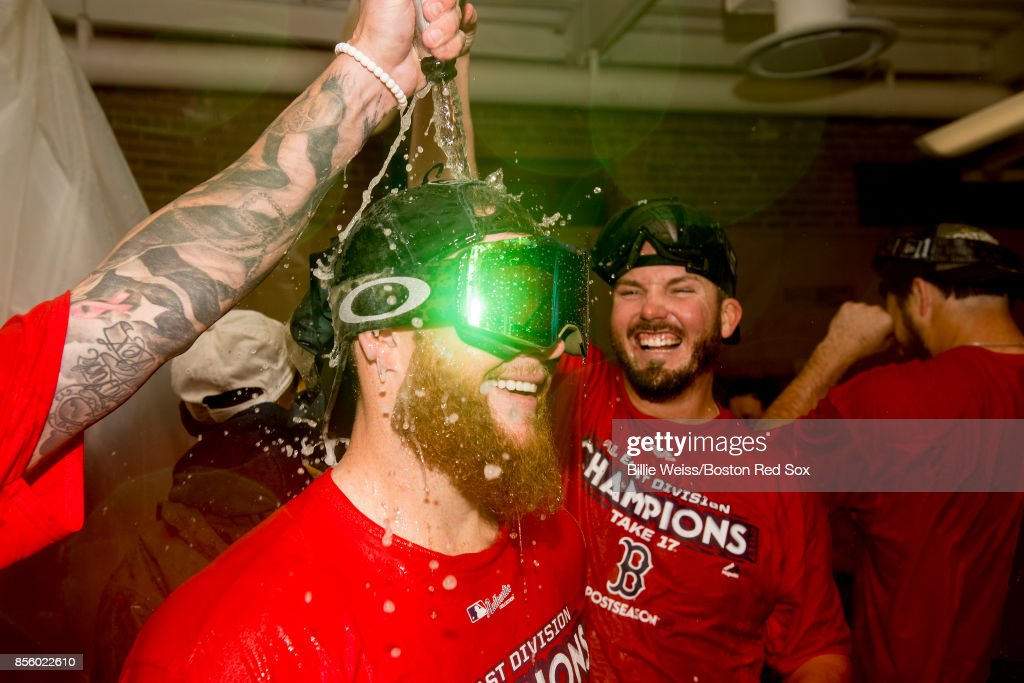 Craig Kimbrel #46 of the Boston Red Sox celebrates in the clubhouse after clinching the American League East Division against the Houston Astros on September 30, 2017 at Fenway Park in Boston, Massachusetts.