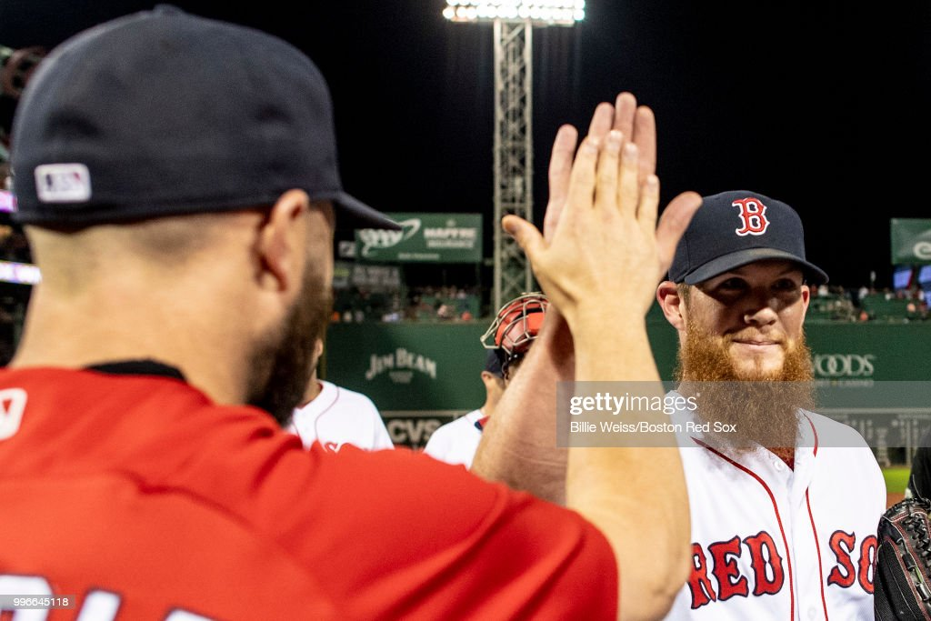 Craig Kimbrel #46 of the Boston Red Sox high fives teammates after a game against the Texas Rangers on July 11, 2018 at Fenway Park in Boston, Massachusetts.