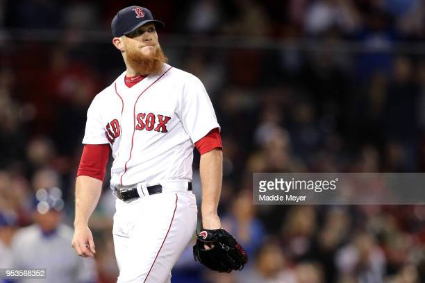 Craig Kimbrel of the Boston Red Sox reacts after Alex Gordon of the Kansas City Royals hit a home run during the ninth inning at Fenway Park on May 1...