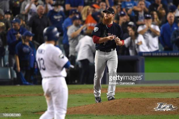 Craig Kimbrel of the Boston Red Sox reacts during the tenth inning against the Los Angeles Dodgers in Game Three of the 2018 World Series at Dodger...