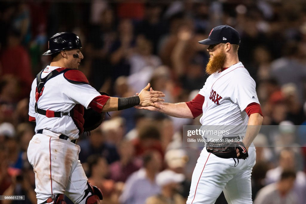 Craig Kimbrel #46 of the Boston Red Sox reacts with Christian Vazquez #7 after recording the final out during the ninth inning of a game against the Los Angeles Angels of Anaheim on June 28, 2018 at Fenway Park in Boston, Massachusetts.