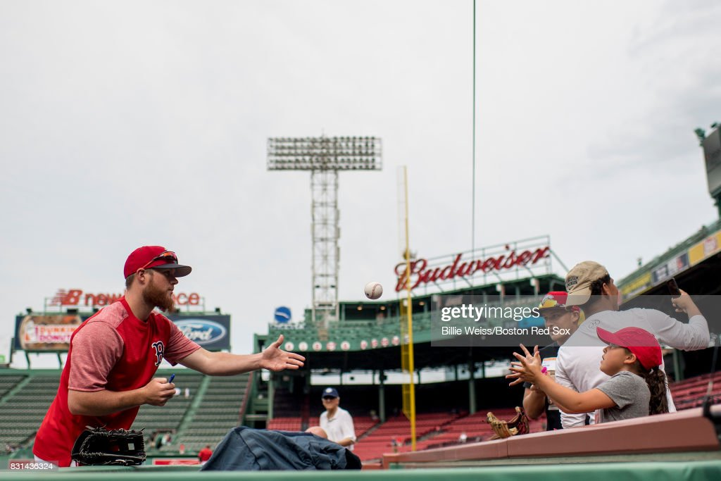 Craig Kimbrel #46 of the Boston Red Sox signs autographs before a game against the Cleveland Indians on August 14, 2017 at Fenway Park in Boston, Massachusetts.