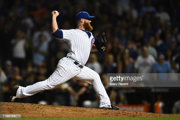 Craig Kimbrel of the Chicago Cubs throws a pitch during the ninth inning against the San Francisco Giants at Wrigley Field on August 20 2019 in...