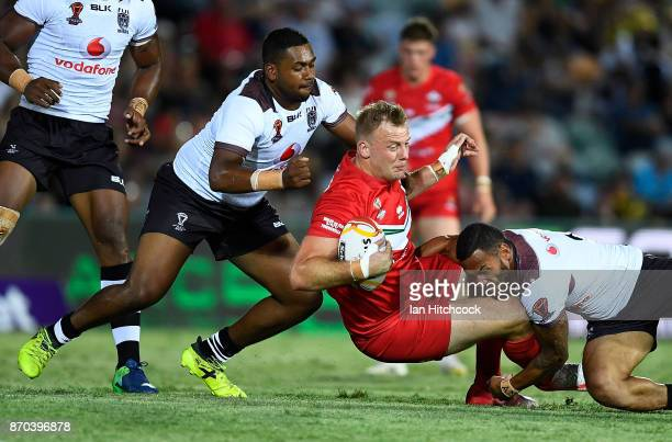 Craig Kopczak of Wales is tackled by Apisai Koroisau of Fiji during the 2017 Rugby League World Cup match between Fiji and Wales at 1300SMILES...