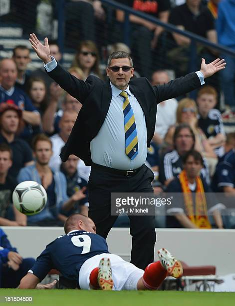 Craig Levein coach of Scotland reacts during the FIFA 2014 World Cup Qualifier at Hampden Park between Scotland and Serbia on September 8 2012 in...