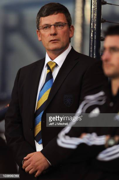 Craig Levein coach of Scotland stands in the dug out during the UEFA Euro 2012 Group I Qualifying match between Scotland and Liechtenstein at Hampden...