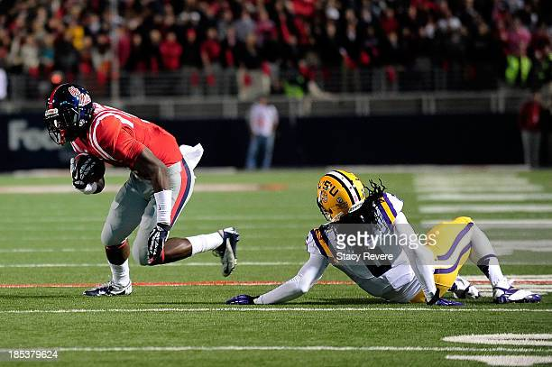 Craig Loston of the LSU Tigers is unable to tackle Laquon Treadwell of the Ole Miss Rebels during a game at VaughtHemingway Stadium on October 19...