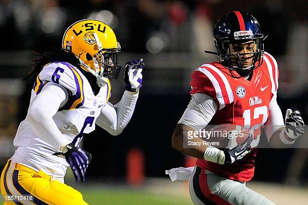 Craig Loston of the LSU Tigers pursues Donte Moncrief of the Ole Miss Rebels during a game at VaughtHemingway Stadium on October 19 2013 in Oxford...
