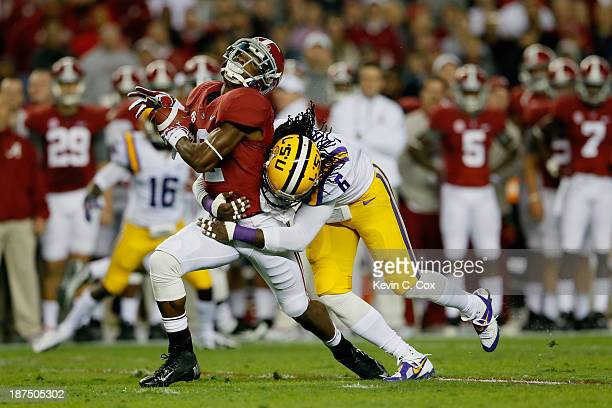 Craig Loston of the LSU Tigers tackles DeAndrew White of the Alabama Crimson Tide in the first quarter of the game at BryantDenny Stadium on November...