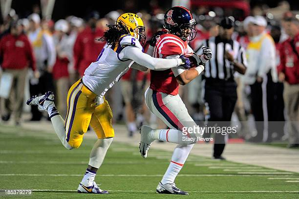 Craig Loston of the LSU Tigers tackles Donte Moncrief of the Ole Miss Rebels during a game at VaughtHemingway Stadium on October 19 2013 in Oxford...