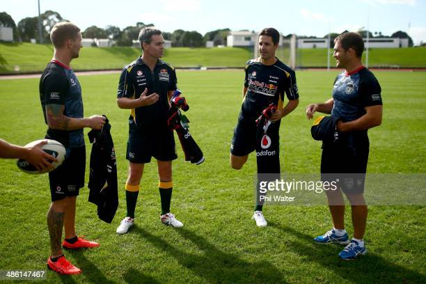 Craig Lowndes and Jamie Whincup of Red Bull Racing chat with the New Zealand Warriors during a joint light training run at Mt Smart Stadium on April...