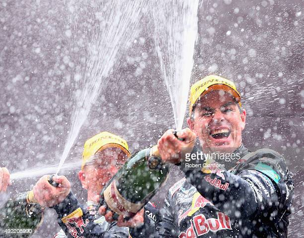 Craig Lowndes and Steven Richards of the Red Bull Racing Australia Holden celebrate on the podium after winning the Bathurst 1000 which is race 25 of...