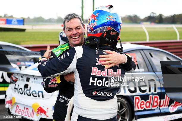 Craig Lowndes driver of the Autobarn Lowndes Racing Holden Commodore ZB congratulates Jamie Whincup driver of the Red Bull Holden Racing Team Holden...
