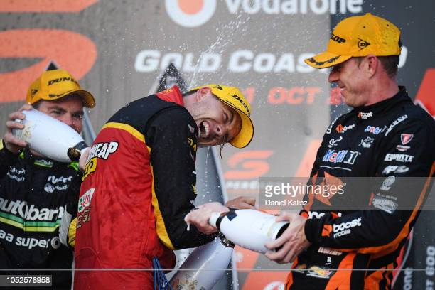 Craig Lowndes driver of the Autobarn Lowndes Racing Holden Commodore ZB Chaz Mostert driver of the Supercheap Auto Racing Ford Falcon FGX and James...