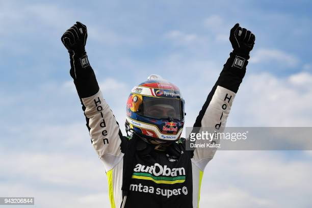 Craig Lowndes driver of the Autobarn Lowndes Racing Holden Commodore ZB celebrates after winning race 2 for the Supercars Tasmania SuperSprint on...