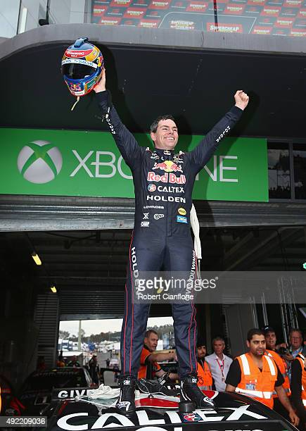 Craig Lowndes driver of the Red Bull Racing Australia Holden celebrates after he and co driver Steven Richards won the Bathurst 1000 which is race 25...