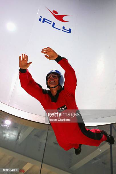 Craig Lowndes driver of the Red Bull Racing Australia Holden attempts indoor sky diving during previews ahead of the Austin 400 which is round five...