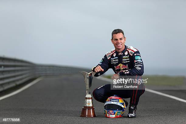 Craig Lowndes driver of the Red Bull Racing Australia Holden poses with the championship trophy ahead of the Phillip Island SuperSprint which is part...