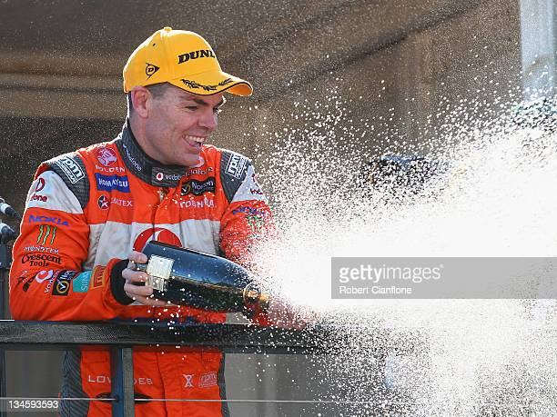 Craig Lowndes driver of the Team Vodafone Holden celebrates after winning race 27 for the Sydney 500 which is round 14 of the V8 Supercars...
