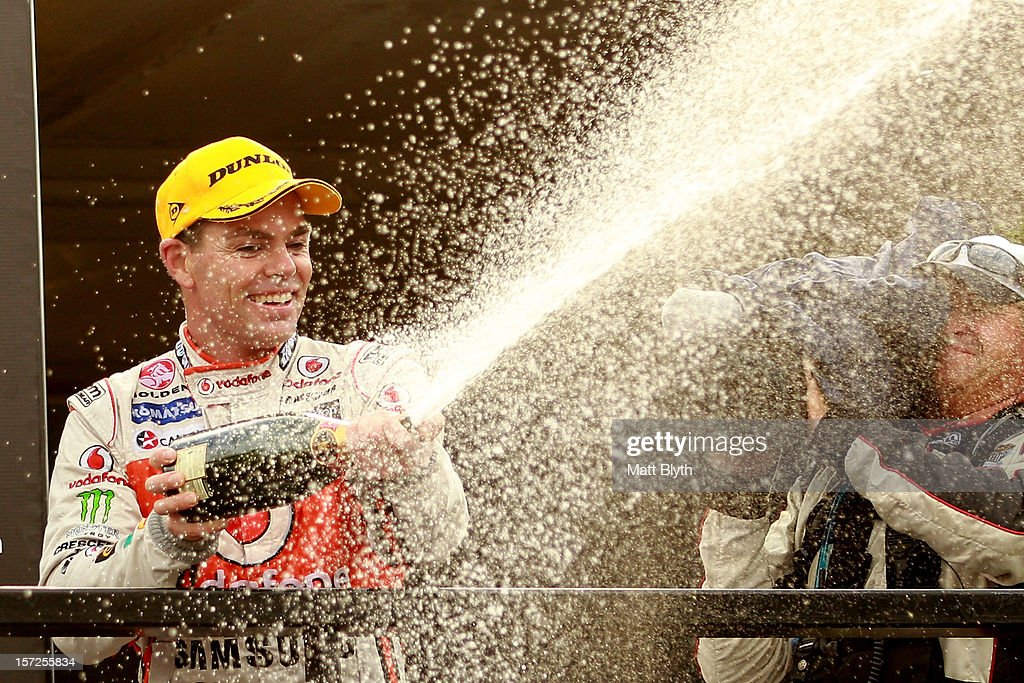 Craig Lowndes driver of the #888 Team Vodafone Holden celebrates after winning race 29 during the Sydney 500, which is round 15 of the V8 Supercars Championship Series at Sydney Olympic Park Street Circuit on December 1, 2012 in Sydney, Australia.