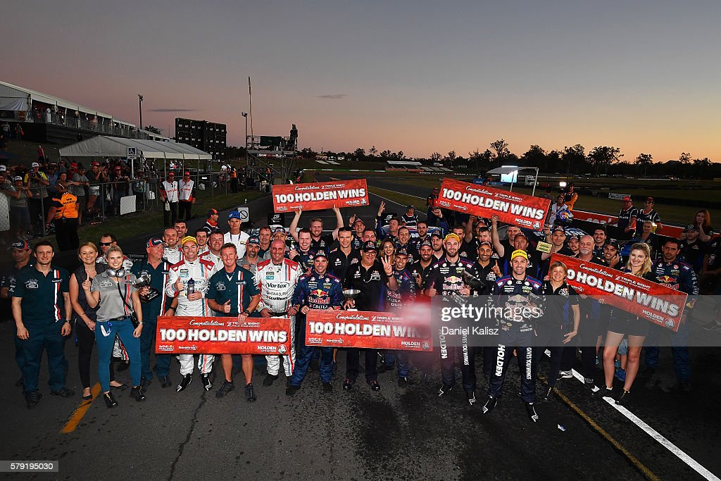 Craig Lowndes driver of the #888 TeamVortex Holden Commodore VF, Shane Van Gisbergen driver of the #97 Red Bull Racing Australia Holden Commodore VF and 88 pose for a team photo after race 1 for the V8 Supercars Ipswich Supersprint on July 23, 2016 in Ipswich, Australia.
