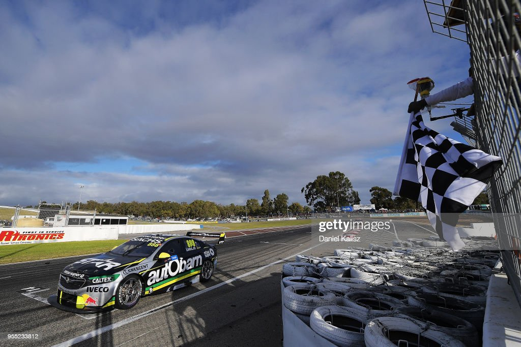 Craig Lowndes drives the #888 Autobarn Lowndes Racing Holden Commodore ZB takes the chequered flag to finish second during race 12 for the Supercars Perth SuperSprint at Barbagello Raceway on May 6, 2018 in Perth, Australia.